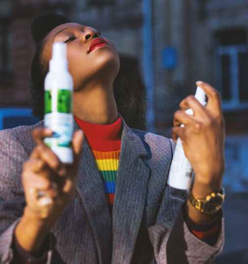 woman using white spray bottle