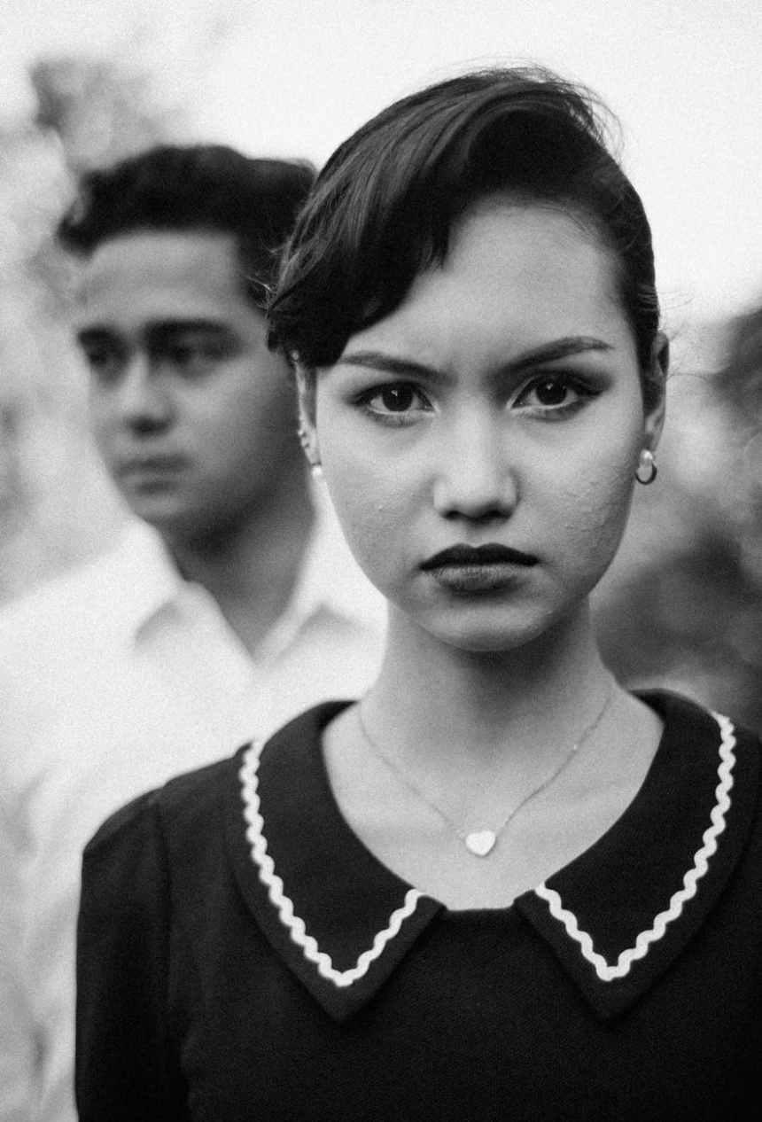 photo of woman wearing necklace