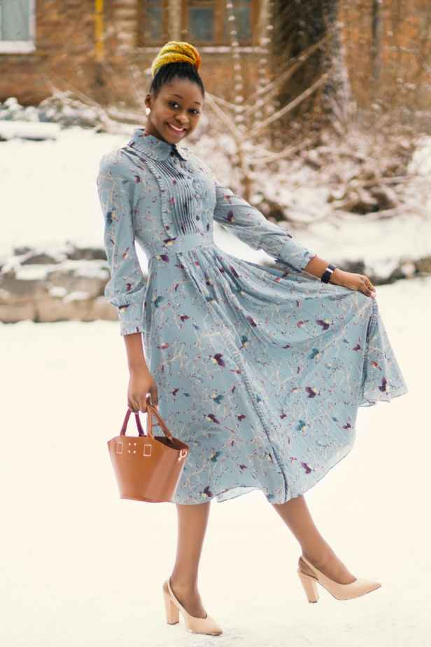 photo of woman wearing blue long sleeved dress